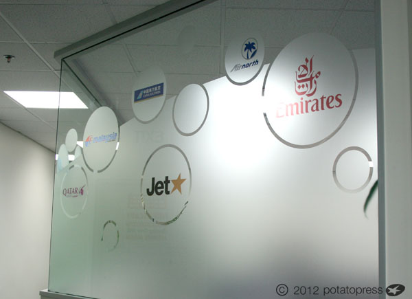 Alpha flight services frosted window graphics potato for Window design graphics